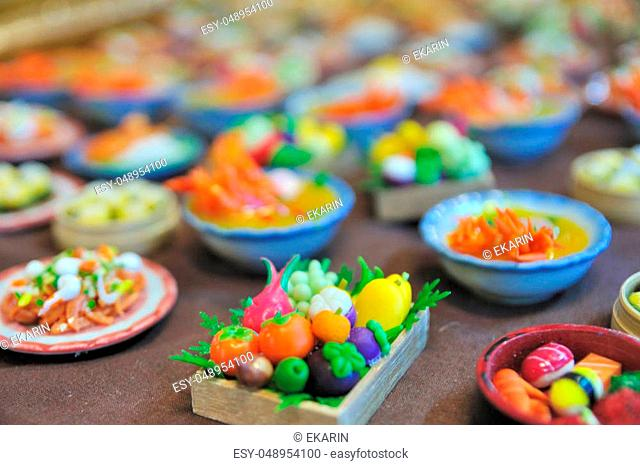 Selective focus, miniature Thai food Thai fruit and Vegetables on wood table