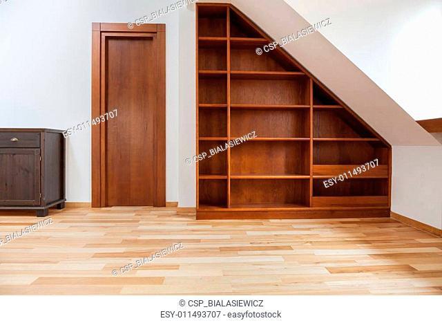 Wooden bookshelf in the attic