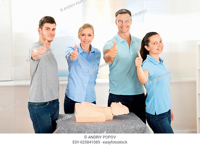 Group Of People Showing Thumbs Up Sign While Learning Resuscitation Training