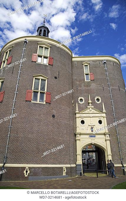 Enkhuizen, a small town in northern Holland, a historic building, entrance to the historic city center, under a blue sky with clouds