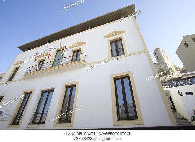 The city hall with flags at Ibiza Old Town, Dalt Vila streets Balearic islands Spain on June 21, 2019