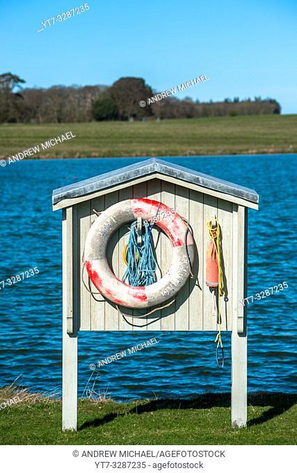 Lifebelt station at Holkham park lake, Norfolk, East Anglia, England, UK