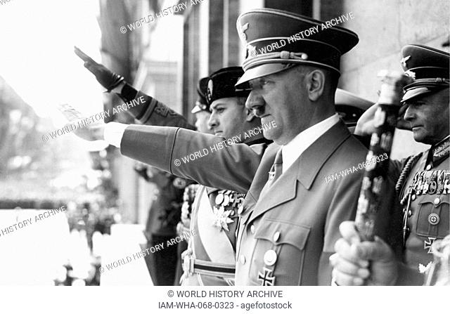 Photograph of Adolf Hitler and Count Ciano saluting on the chancellery balcony, Berlin. Dated 1943