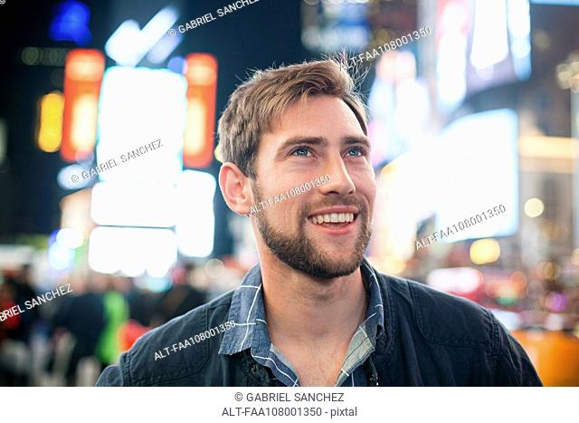 Young man amazed by his surroundings, Times Square, New York City, New York, USA