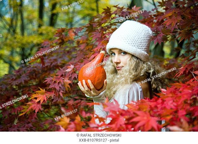 Autumn portrait of young woman