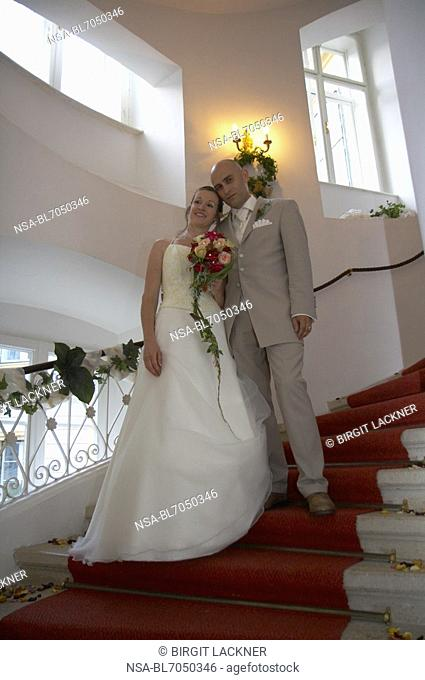 bridal couple on stairs