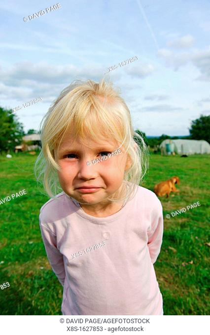 Stock photo of a 6 year old girl outside in the garden