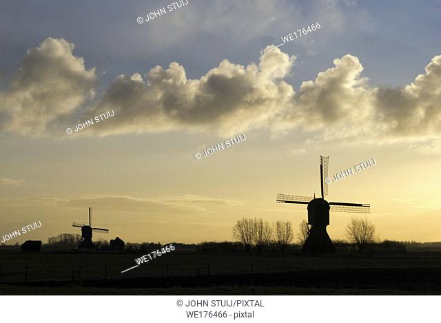Windmill the Zandwijkse molen near Uppel just before sunset with the Uitwijkse molen in the background
