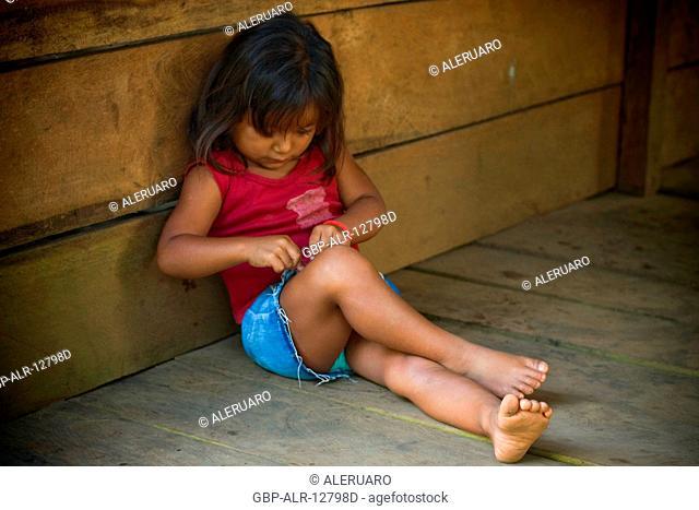 Seating child in the Ground, Terra Preta Community, Cuieiras River, Amazônia, Manaus, Amazonas, Brazil