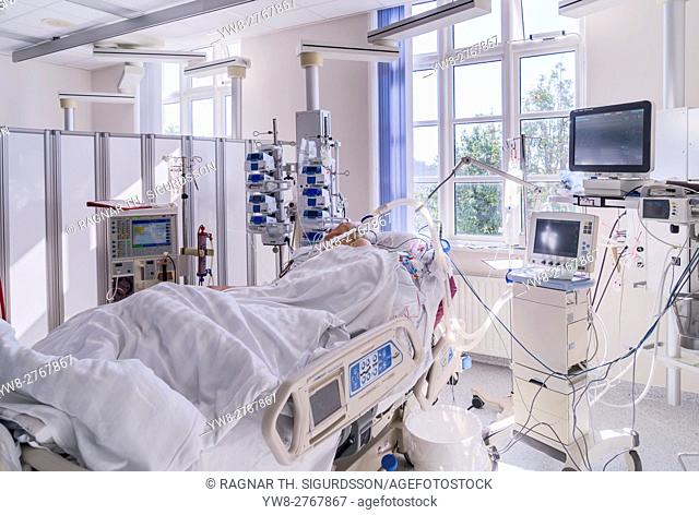 Patient in recovery after heart valve replacement surgery, operating room, Reykjavik, Iceland