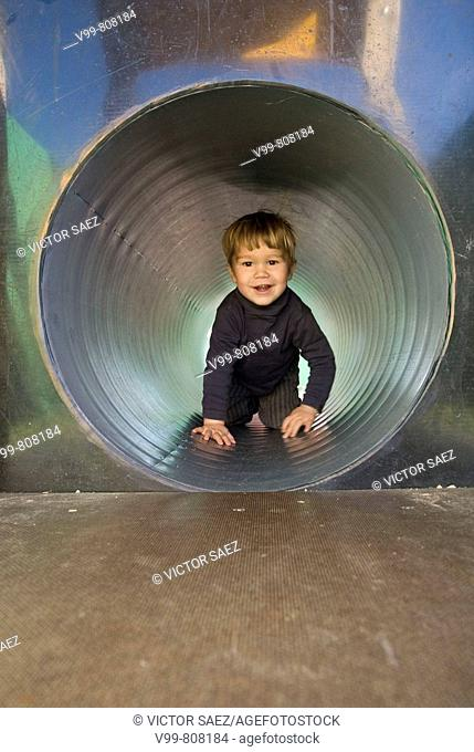 child in a tunnel