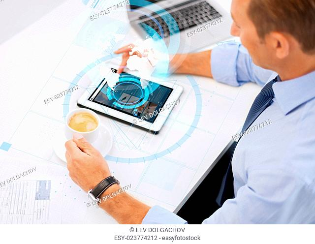 business, people, mass media and technology concept - businessman with tablet pc reading internet news and drinking coffee in office