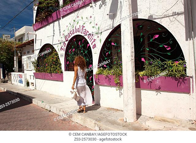 Woman walking in the street of town center, Isla Mujeres, Quintana Roo, Yucatan Province, Mexico, Central America