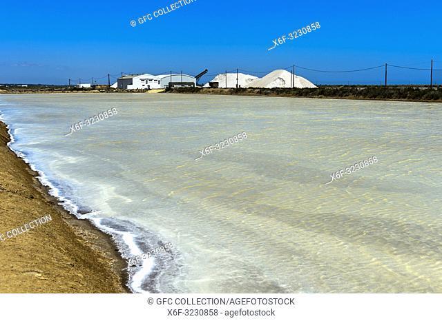 Sea salt production, salt evaporation ponds, Sopursal saline, Santa Luzia, Algarve, Portugal