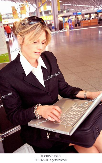 Young Businesswoman with laptop, traveling