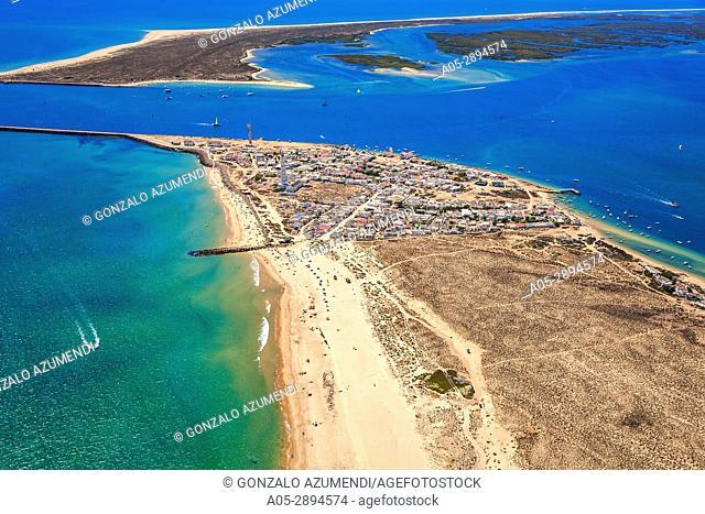 In the foreground Farol island. In the background Deserta island. Faro district. Algarve. Portugal