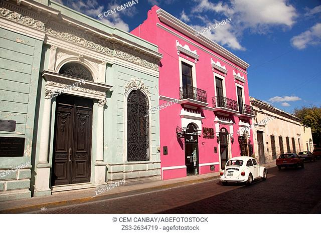Cars in front of colorful colonial buildings at the city center, Merida, Yucatan Province, Mexico, Central America