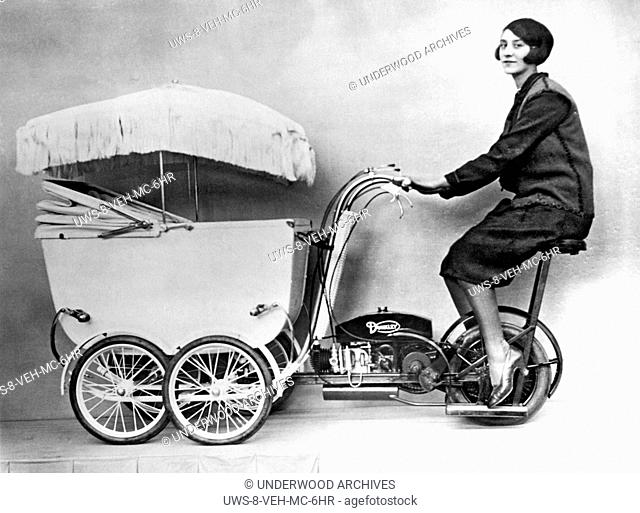 London, England: c. 1930.The latest invention in transportation and baby care at the British Industries Exhibition is the new fangled Pramobile