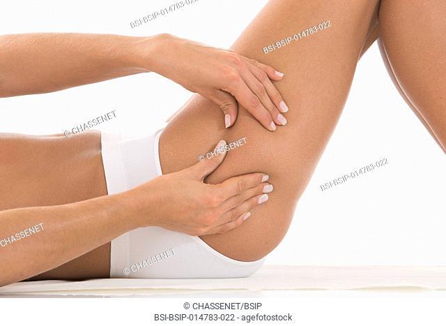 Woman pinching her thigh