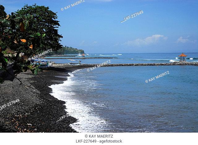 Stony beach at the coast at Candi Dasa, East Bali, Indonesia, Asia