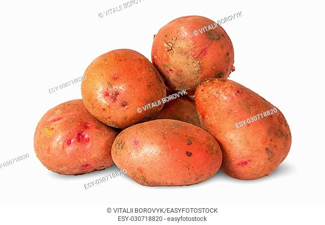 Pile of dirty potatoes isolated on white background