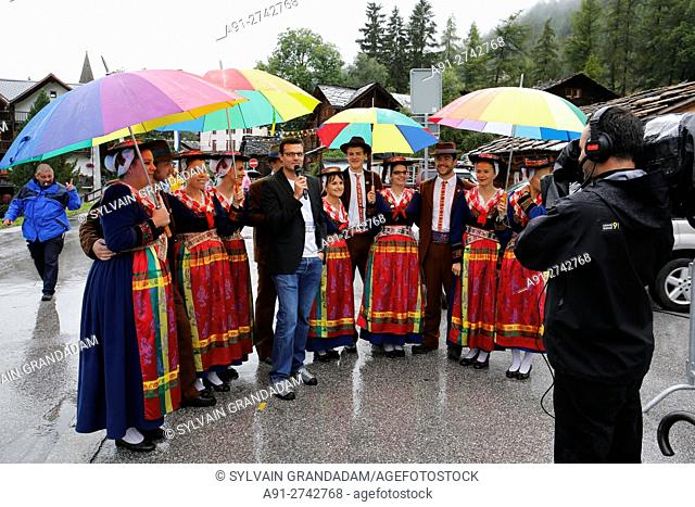 Switzerland, Valais, Val d'Herens, village of Evolene at fall, CIME festival where are performed many folkloric activities , the TV is here