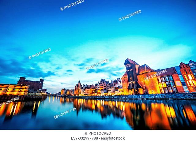 Gdansk old town and famous crane, Polish Zuraw. View from Motlawa river, Poland at romantic sunset, night. The city also known as Danzig and the city of amber