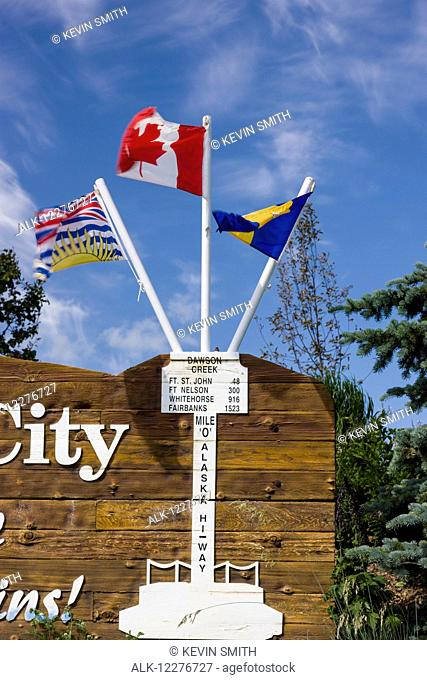 Flags on the Mile Zero City Sign, the Start of Alaska Highway, Dawson Creek, British Columbia, Canada, Summer