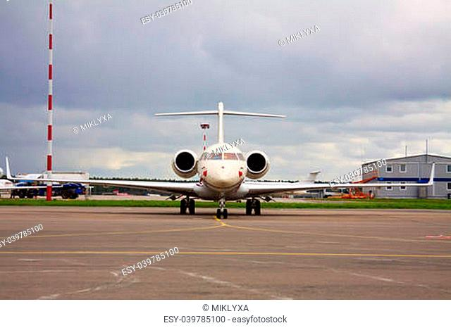 business jet at the airport on a cloudy day