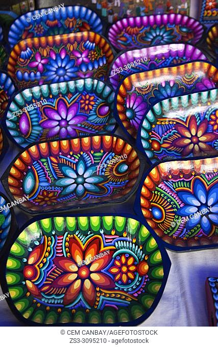 Close-up shot of colorful wooden trays in Otavalo art and craft market, Quito Area, Imbabura Province, Ecuador, South America