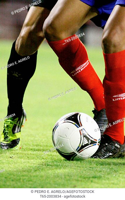 Date: 12-9-2012.Lugo Cup match CD Lugo - Racing Santander. Two players fight for the ball