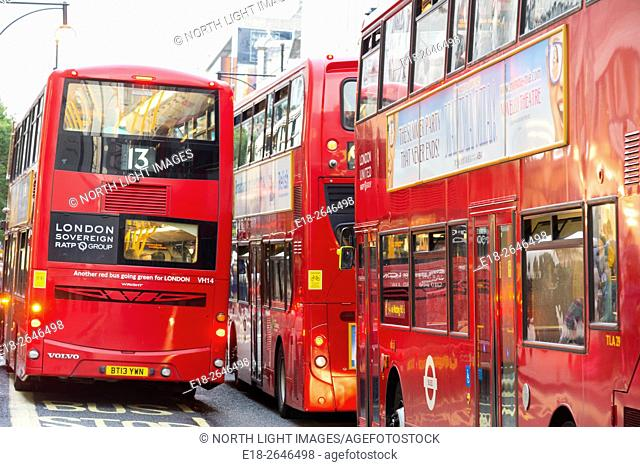 UK, England, London. Oxford Street. Three double decker buses blocking the street
