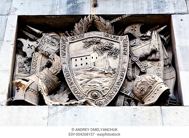 Shield, Helmets and Sword Marble Relief in Genoa, Italy