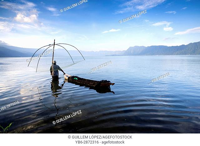 A fisherman at work using traditional system at the Lake Maninjau, West Sumatra, Indonesia