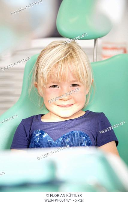 Portrait of smiling girl in dentist's chair