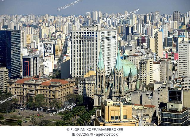 Skyscrapers, sea of houses, Cathedral da Se and Praca da Se square at front, São Paulo, São Paulo, Brazil