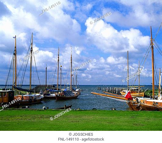 Boats at harbor under cloudy sky, Mecklenburg-Vorpommern, Germany