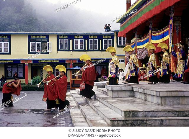Lamas of the Kagyu pa sect  yellow hat come out of  Ralang monastery for the ceremonial masked dances on the occasion of the birthday celebrations of Guru...