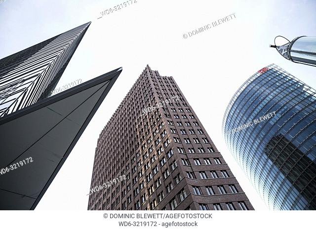 Upward view of tall buildings and a light tube at Potsdamer Platz in Berlin, Germany