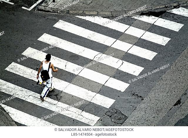 Walking through the pedestrian crossing