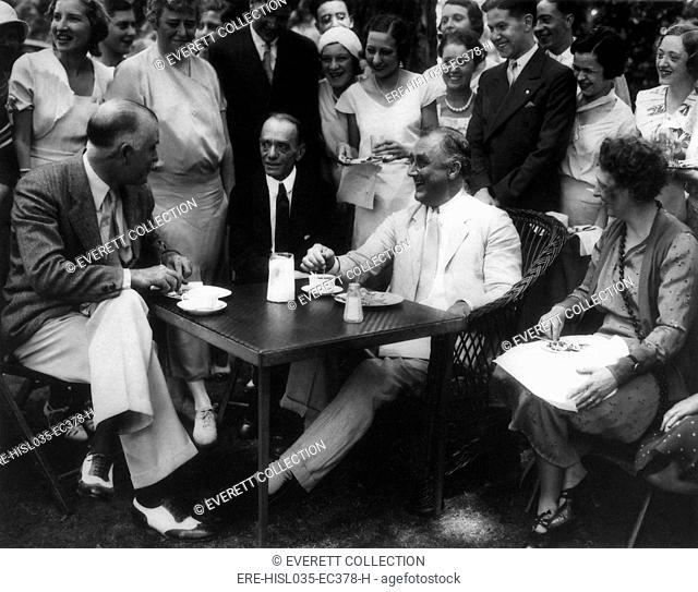Governor Franklin Roosevelt with group at Hyde Park. July 7, 1932. At FDR's right is his long-time political adviser, Louis Howe. (BSLOC-2013-6-122)
