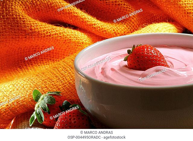 a bowl of strawberry mousse cream