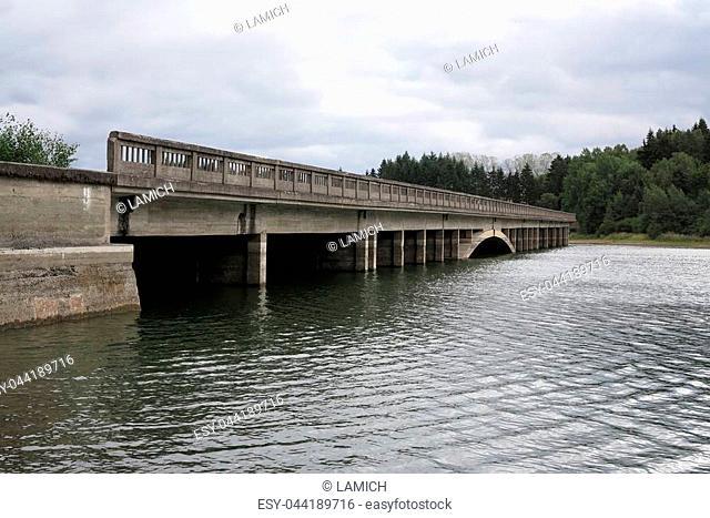 Unfinished highway bridge across the water reservoir Svihov from World War II, Czech republic
