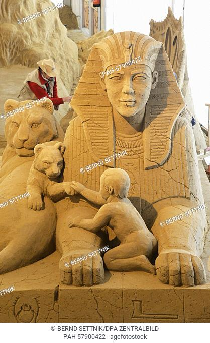 The sand sculpture titled ' Sphinx with Lions' by Latvian artist Maija Puncule is ready on display during the '1. Berliner Sandwelt'