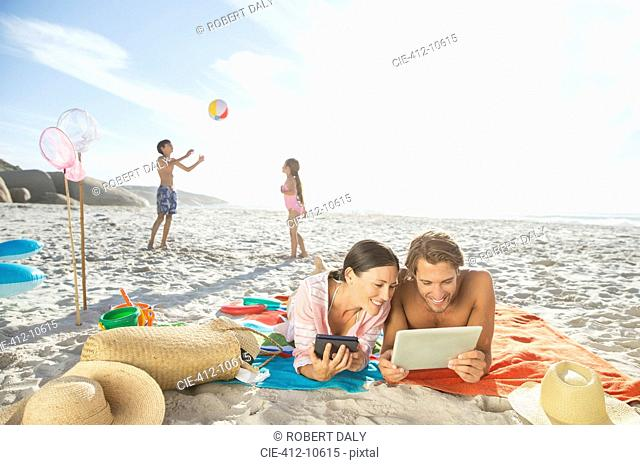 Family relaxing together on beach