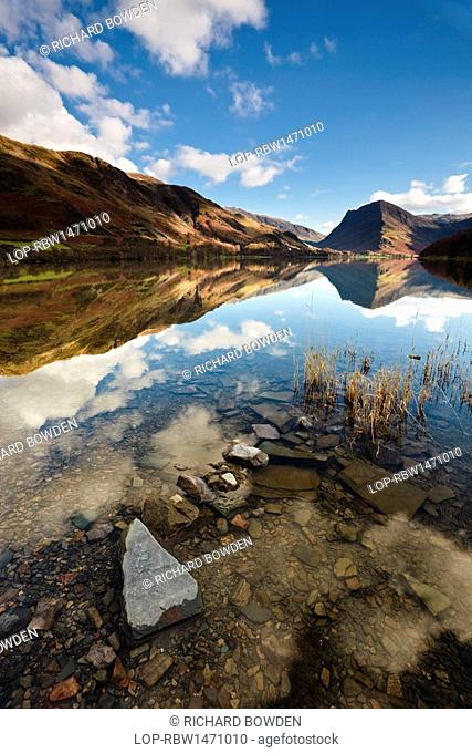 England, Cumbria, Buttermere. The surrounding mountainside reflected in the calm waters of Buttermere lake