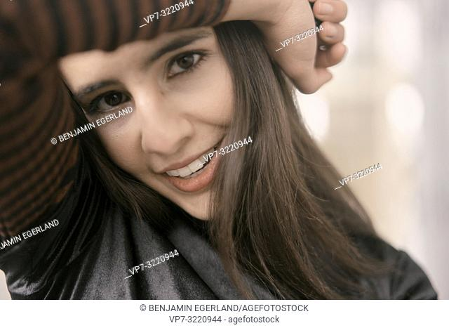 close-up portrait of playful woman, flirty, coy, in Munich, Germany