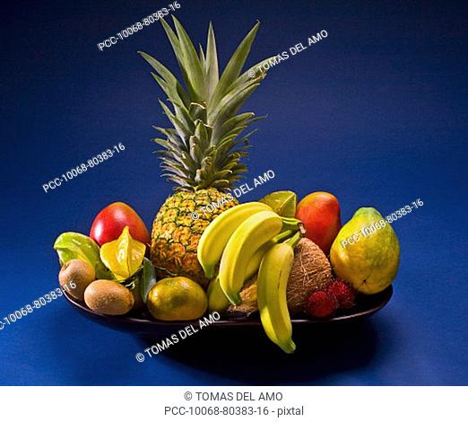 Studio shot of a variety of tropical fruit in a bowl