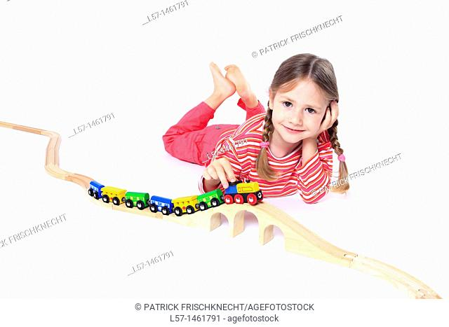 Little girl playing with wooden railway, Switzerland