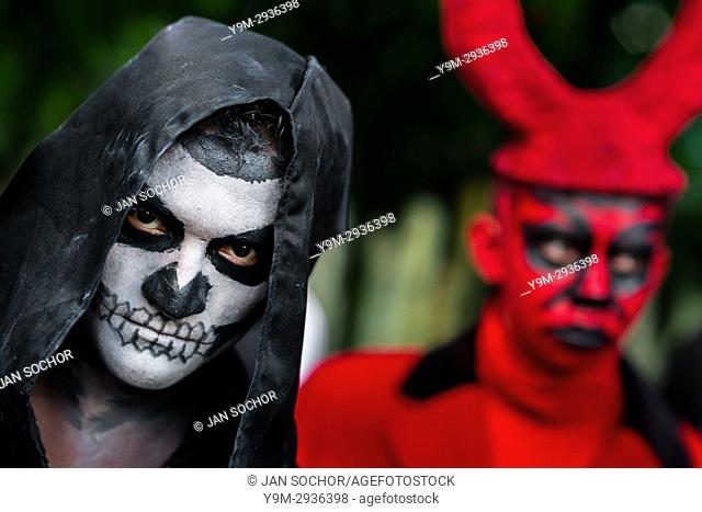 A young Salvadoran man with skull face paint takes part in the La Calabiuza parade at the Day of the Dead celebration in Tonacatepeque, El Salvador